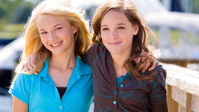 Teenage girl friends embracing
