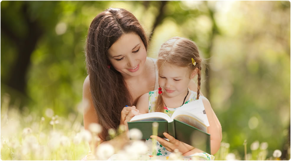 mother and child reading outdoors